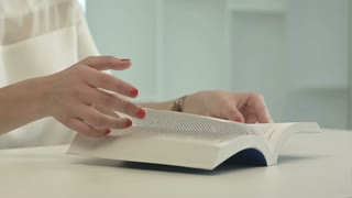 Woman sitting table and reading book