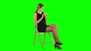 Young Business Woman Using Telephone on a Green Screen