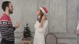 Young couple get christmas gifts from their friend.