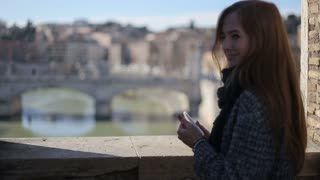 young female enjoying the view of tiber in rome