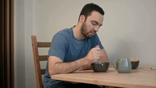 Young man having no appetite for his breakfast