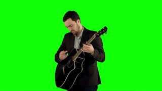 Young man playing guitar on a Green Screen