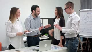 Young office workers having fun during business meeting