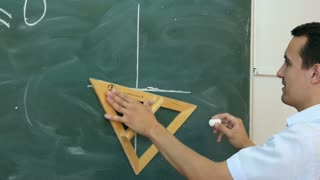 Young teacher or student draw line chart on a blackboard with formula