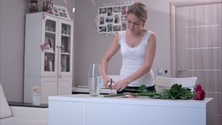 Young woman cutting stems on bunch of roses