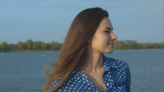 Young woman meets a man. Waterfront. Closeup