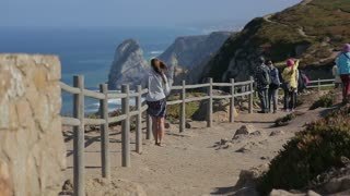 young woman staring at the ocean in Cabo da Roca, atlantic border of europe