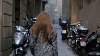 Young woman walking throught motorcycle parking