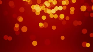 Defocused particles falling on red background