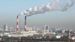 Aerial view of Moscow with smoke goes from tubes of power plant in cold day at winter