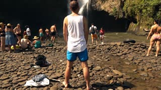 3 07 2016, Bali, Indonesia: Tourists relaxing at the beautiful waterfall in the jungle, super slow motion
