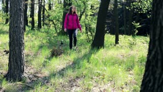 A lost young woman trekking in the forest
