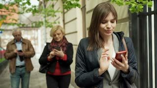 Addicted people walking with smartphones in the city