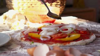 adding a spoon of olive oil to pizza, super slow motion, shot at 240fps
