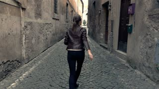 Afraid, scared woman running through street in the city,  super slow motion