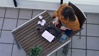 Angry female writer having creativity crisis during working at her book, on terrace