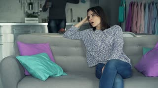 Attractive young couple arguing on sofa at home, 4K