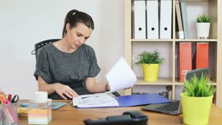 Beautiful businesswoman suffering from headache in the office