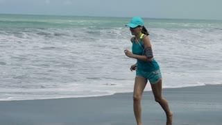 Beautiful Woman running on beach, 120fps
