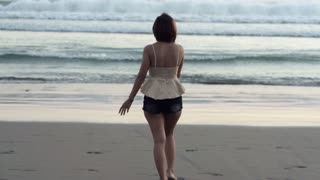 Beautiful woman walking on the beach super slow motion, shot at 240fps