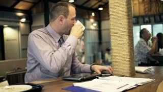 Businessman drinking coffee in cafe and leave for work in the morning HD