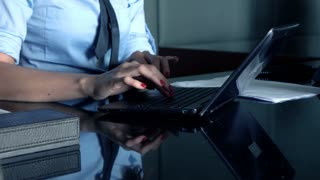 Businesswoman hands typing on laptop by table in the office, 4K