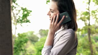 Businesswoman talking on cellphone while on terrace