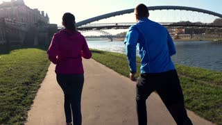 Couple jogging on road in the city super slow motion, shot at 120fps
