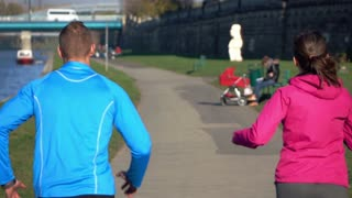 Couple jogging on road in the city super slow motion, shot at 240fps