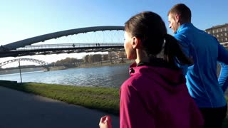 Couple jogging on the road in the city super slow motion, shot at 120fps