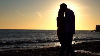 Silhouette of couple dancing during sunset, super slow motion