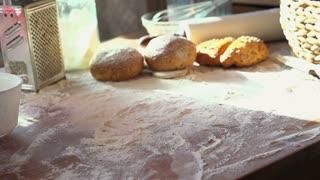 Crusty bread falling on table, super slow motion 240fps