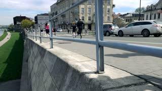 Editorial: People legs racing in marathon, super slow motion