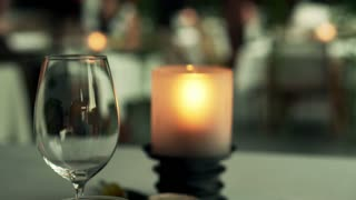 Empty wine glass on table in cafe at night