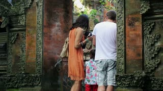 family sightseeing ancient temple in Ubud, Bali