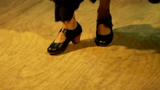 female legs dancing flamenco at bar in Seville,
