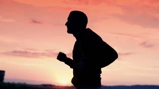 handsome man jogging in the country super slow motion, 240Fps
