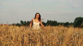 happy, beautiful woman running cross wheat field super slow motion, 240Fps