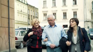 Happy family talking and walking in the city