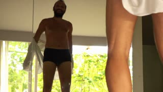 Happy man jumping on bed, super slow motion