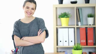 Happy, smiling businesswoman standing at office