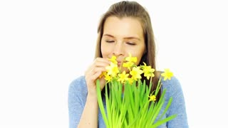 happy woman smell flowers isolated on white