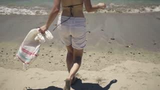 Happy young woman enjoying beautiful exotic beach