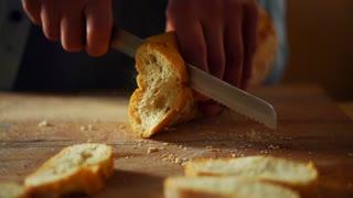 Man hand slicing bread