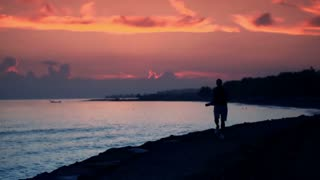 man jogging during sunset by the sea, super slow motion, 240fps HD
