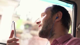 Man listen to music while riding car, 240fps
