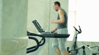 man running on the treadmill at the gym
