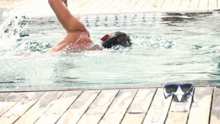 Man swimming in pool, super slow motion