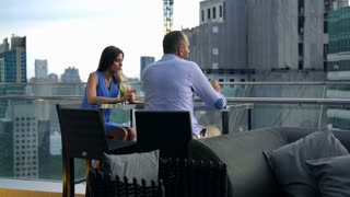 Offended, sad couple sitting on terrace in cafe, 4k