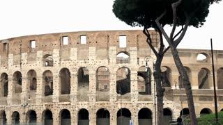 Pan shot of Flavian amphitheatre Colloseum in Rome